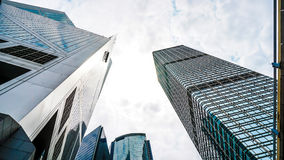 Modern glass buildings from low angle with sky shot. Concept wor Stock Photos
