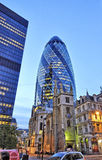 The modern glass buildings of the Swiss Re Gherkin Royalty Free Stock Photos