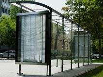 Modern glass bus shelter with polka dots on aluminum frame royalty free stock image