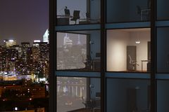 Modern glass byggnad i nattstad Fotografering för Bildbyråer