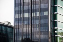 A modern glass commercial building in city downtown Royalty Free Stock Photos