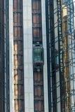 Modern glass elevator. Modern building and glass elevator Stock Photos