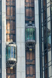 Modern glass elevator. Modern building and glass elevator Stock Image