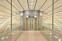 Modern glass elevator at train station Royalty Free Stock Image