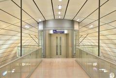 Modern glass elevator at train station. Modern glass elevator inside Hamburg International Airport Train station Royalty Free Stock Image