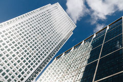 Modern glass exterior of corporate office buildings shot from a. Low angle Stock Photos
