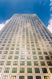 Modern glass exterior of corporate office buildings shot from a. Low angle Royalty Free Stock Image