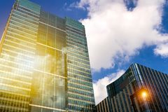 Modern glass exterior of corporate office buildings shot from a. Low angle Royalty Free Stock Photos