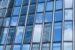Glass facade on skyscraper in Frankfurt am Main. Modern glass facade on high-rise in Frankfurt am Main Royalty Free Stock Image