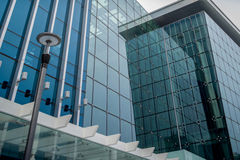 Modern glass front building low to high aspect. Glass front building, blue glass, low to high aspect royalty free stock images