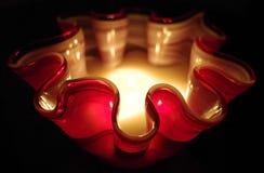 Modern glass krabb stearinljus på natten Arkivfoto
