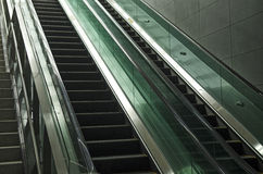 Modern glass and metal escalator Stock Images