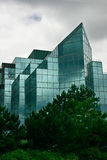 Modern Glass Office Building. This is a modern glass office building reflecting dark clouds Royalty Free Stock Images