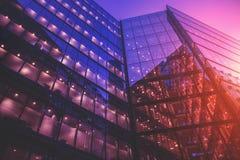 Modern glass office buildings at sunset. Modern office buildings in London at sunset stock photo