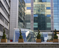 Modern glass offices with refl. Reflections in a modern glass office building Stock Image