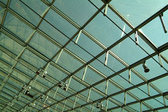 Modern glass roof. Against blue sky Royalty Free Stock Photo