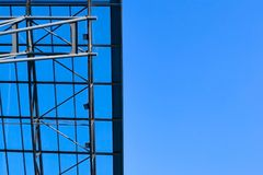 Modern glass roof. In the background of blue sky. An empty space for the text stock images