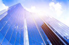 Modern glass silhouettes of skyscrapers in the city and dramatic sunlight Royalty Free Stock Photo