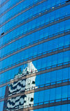 Modern glass skycraper with building  reflection Royalty Free Stock Photography