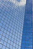 Modern glass skyscraper with clouds Royalty Free Stock Photography