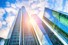 Modern glass skyscrapers. Against the blue sky at sunset. Bottom up view stock image