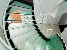 Modern glass spiral staircase Stock Photography
