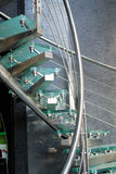 Modern Glass Staircase. A striking modern glass staircase with green glass and chrome against a textured gray wall Royalty Free Stock Image