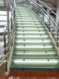 Modern glass stairs. Modern matted glass stairs with metallic hand-rails Royalty Free Stock Image