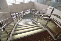 Modern glass stairs. Modern stained and matted glass stairs with metallic hand-rails Stock Photos