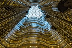 Modern glass and steel high rise builoding interior. Glass and steel interior of large high rise corporate office in the central business district of a large royalty free stock photo