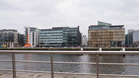 Modern glass and steel office buildings in the redeveloped Docklands area of Dublin, Ireland royalty free stock image