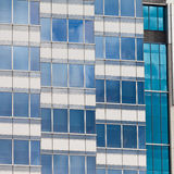 Modern glass-walled highriser building facade Stock Photo