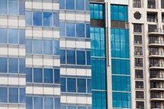Modern glass-walled highriser building facade Stock Photo