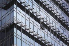 Modern glass walled skyscraper exterior Stock Photos