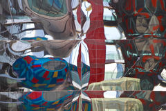 Modern glass walls reflecting abstract distorted reflection Stock Photo