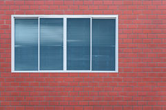 Modern glass window on the brick wall Stock Photos