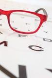 Modern glasses on a eye sight test chart Royalty Free Stock Photo