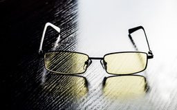 Modern glasses to eye protection with yellow lenses Stock Photography