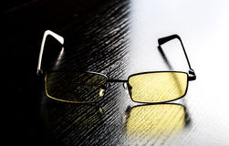Modern glasses to eye protection with yellow lenses Royalty Free Stock Images