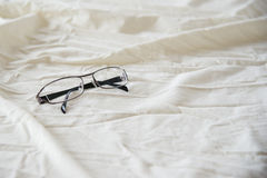 Modern Glasses on white bed Royalty Free Stock Photography