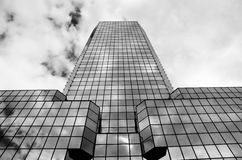 Modern glassy building, shot from bottom. Modern glassy office building in black and white Stock Photos