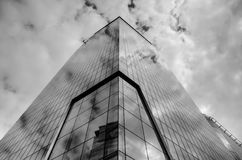 Modern glassy building, shot from bottom. Modern glassy office building in black and white. Shot made from corner Stock Images
