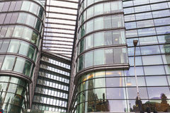 Modern glazed office building in London, business center,London, United Kingdom. LONDON, UNITED KINGDOM - JUNE 22, 2017: Modern glazed office buildings in London Royalty Free Stock Photos