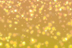 Modern gold abstract background with bokeh defocused lights. Royalty Free Stock Photo