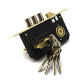 Modern gold and black lock with bunch of keys  Royalty Free Stock Images