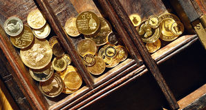 Modern gold coins in a wooden casket Stock Photo