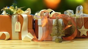 Modern gold, copper and white wrapped Christmas gift Stock Photos