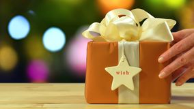 Modern gold, copper and white wrapped Christmas gift Royalty Free Stock Photography