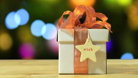 Modern gold, copper and white wrapped Christmas gift Royalty Free Stock Photo