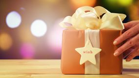 Modern gold, copper and white wrapped Christmas gift royalty free stock images